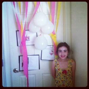 Sweet Pea with her birthday door.