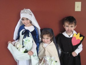 St. Elizabeth of Hungary, St. Therese, and St. Lawrence.